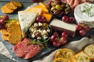 meats, cheeses, and grapes